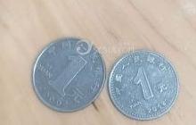 親愛的論壇朋友們這個硬幣是假的嗎,銀行沒